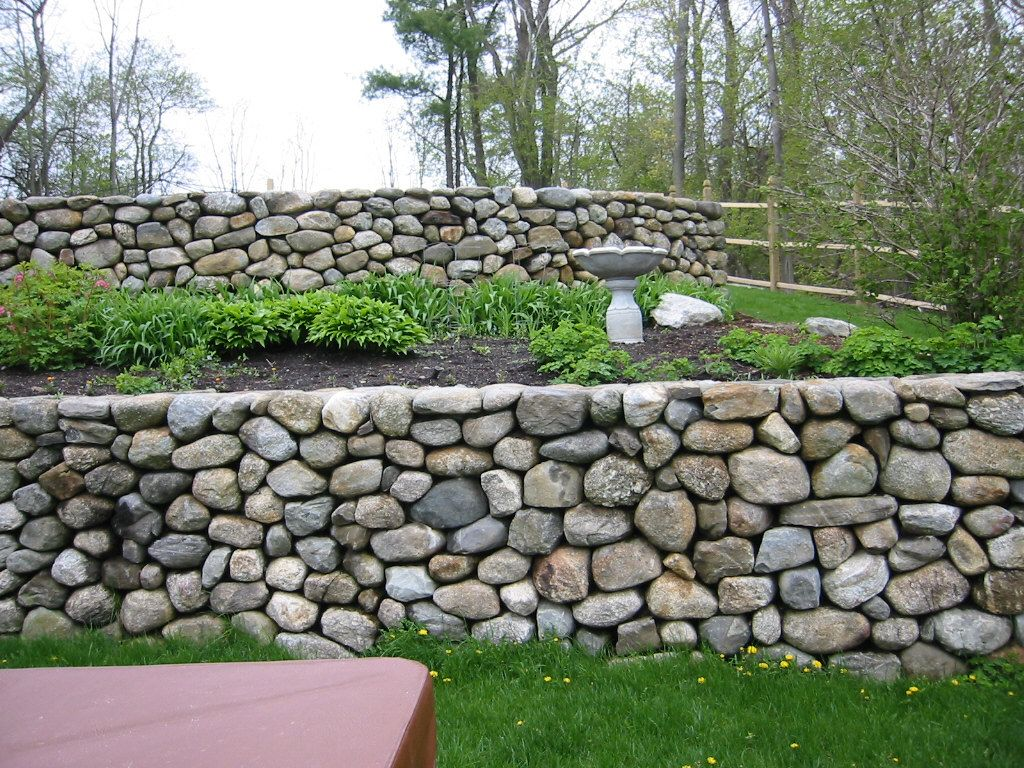 Retaining wall design ideas google search walkout for Stone retaining wall design