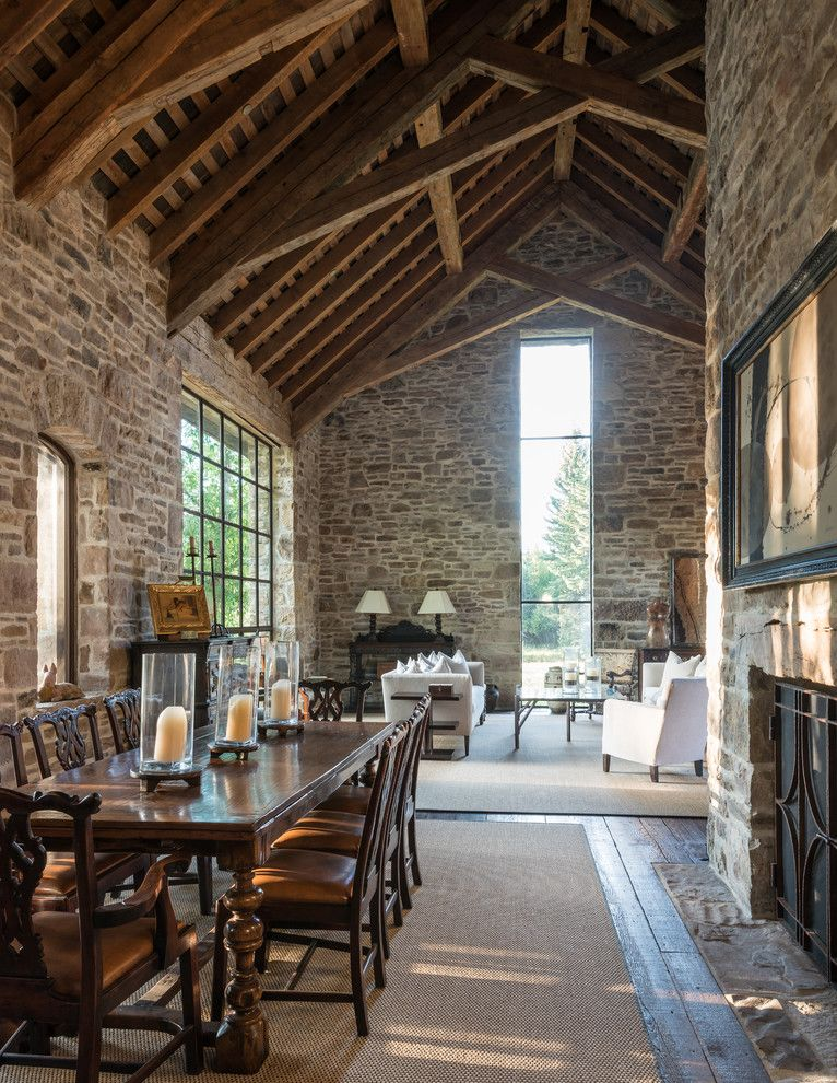 stone walls cathedral rafters lend old world timelessness to spacious open living area - Old World Design Homes