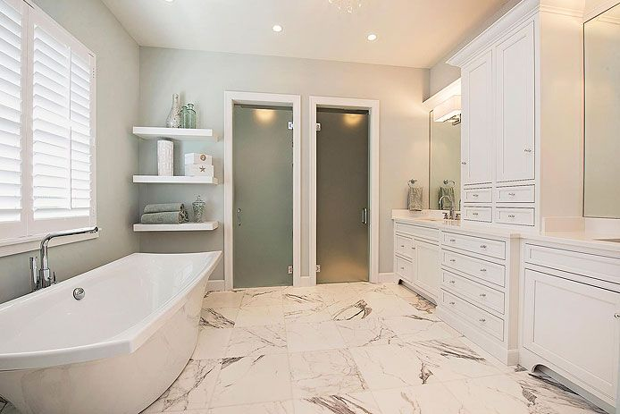 Bathroom Featuring White Grabill Cabinets.