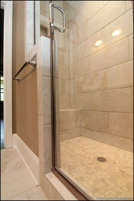 Long shower with built in bench. Pebble style floor inside the ...