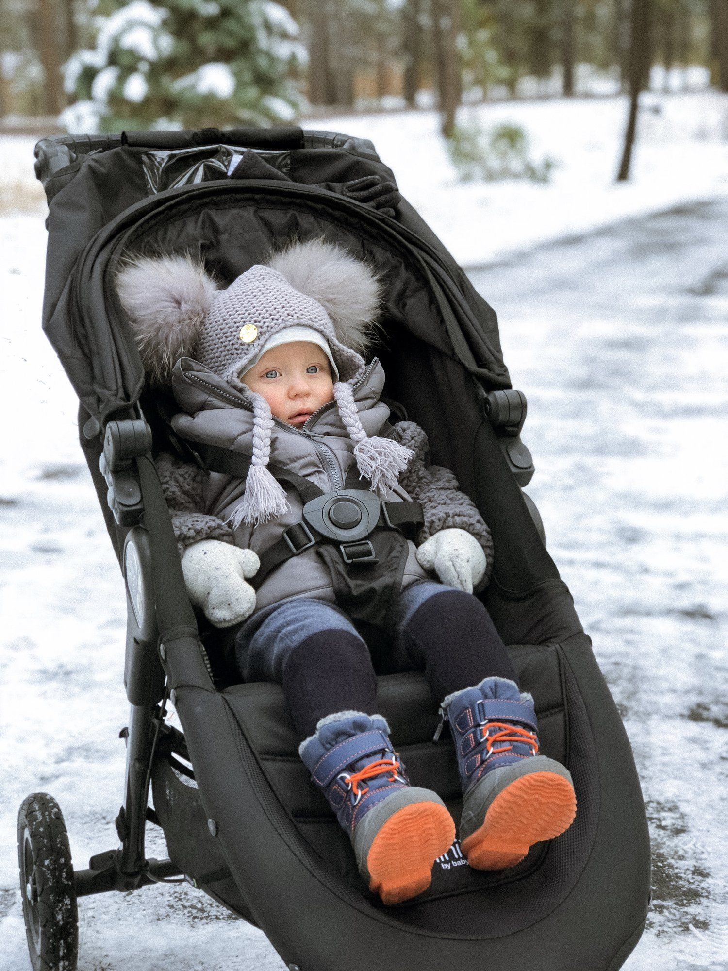 Baby Jogger City Mini GT stroller in the snow. Miloves hat