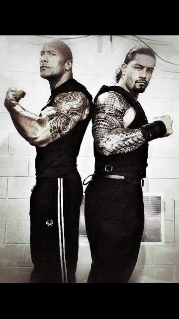 The Rock and his cousin Roman Reigns. They are also ...