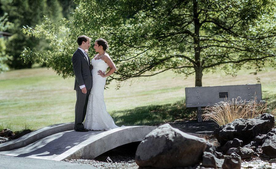 Matt Shumate Photography at Lawson Gardens outdoor summer wedding bride and groom portrait standing on a bridge