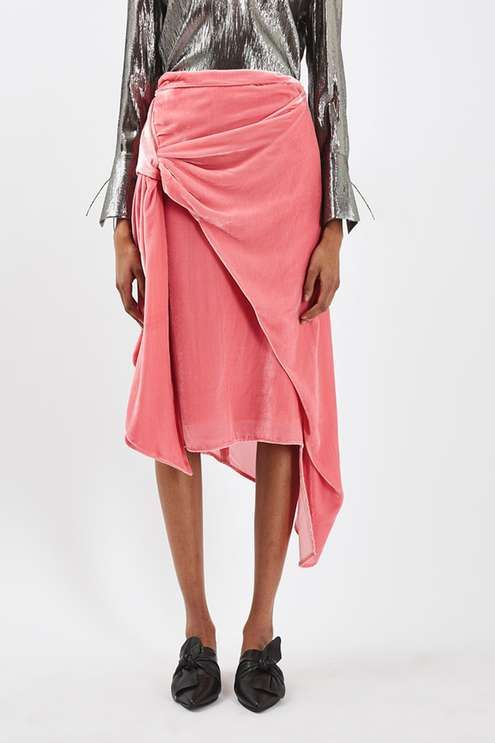 Incorporate on-trend velvet into your wardrobe with this luxe skirt by Boutique. In a pretty pink, it comes in an ultra-flattering wrap design and is finished with sash detailing. Pair with a metallic blouse for a statement look. Made in Britain. By Boutique. #Topshop