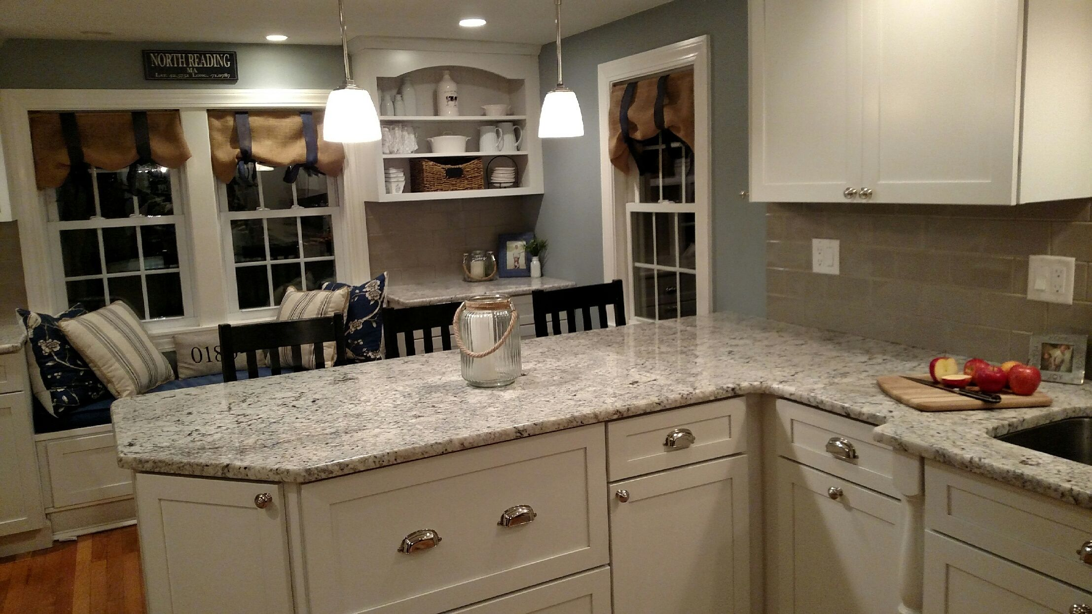 White Ice Granite Thornton Shaker Cabinets by KraftMaid
