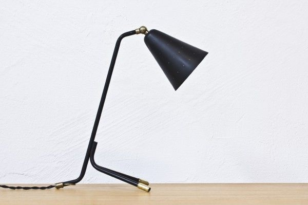 LI — 093 | Tack Market.Stunning table lamp designed by Svend Aage Holm Sørensen for Holm Sørensen & Co, Denmark, during the 1950′s. Black lacquered lamp with adjustable shade with a die cut dot pattern. Polished brass joints.