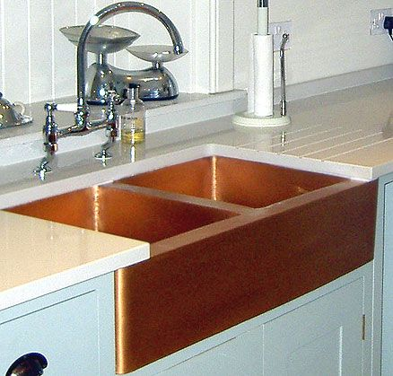 An A Front Double Bowl Copper Kitchen Sink In Combination With White Backsplashes Countertops And Cabinets