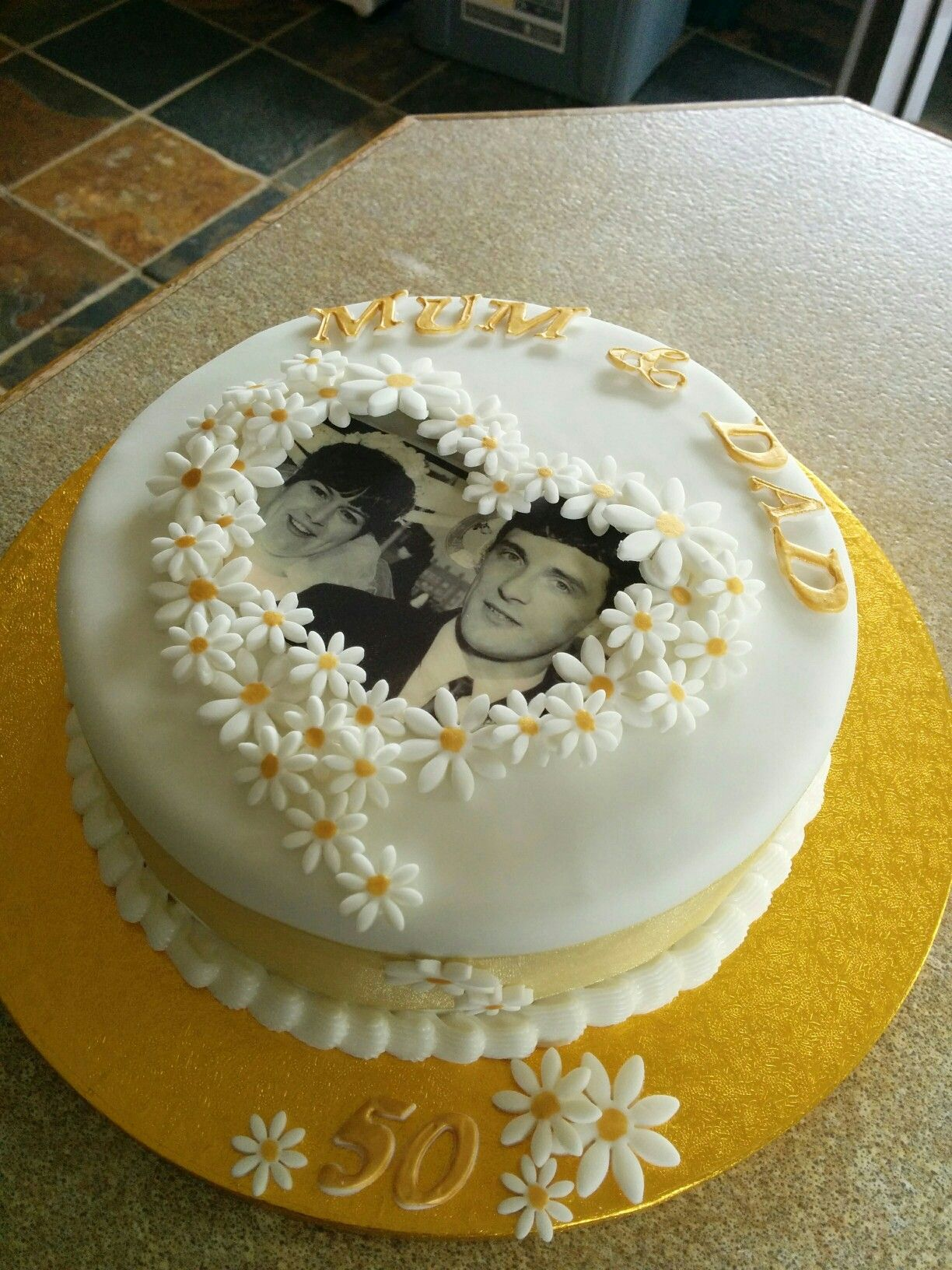 Golden wedding anniversary cake with edible photo and golden daisies