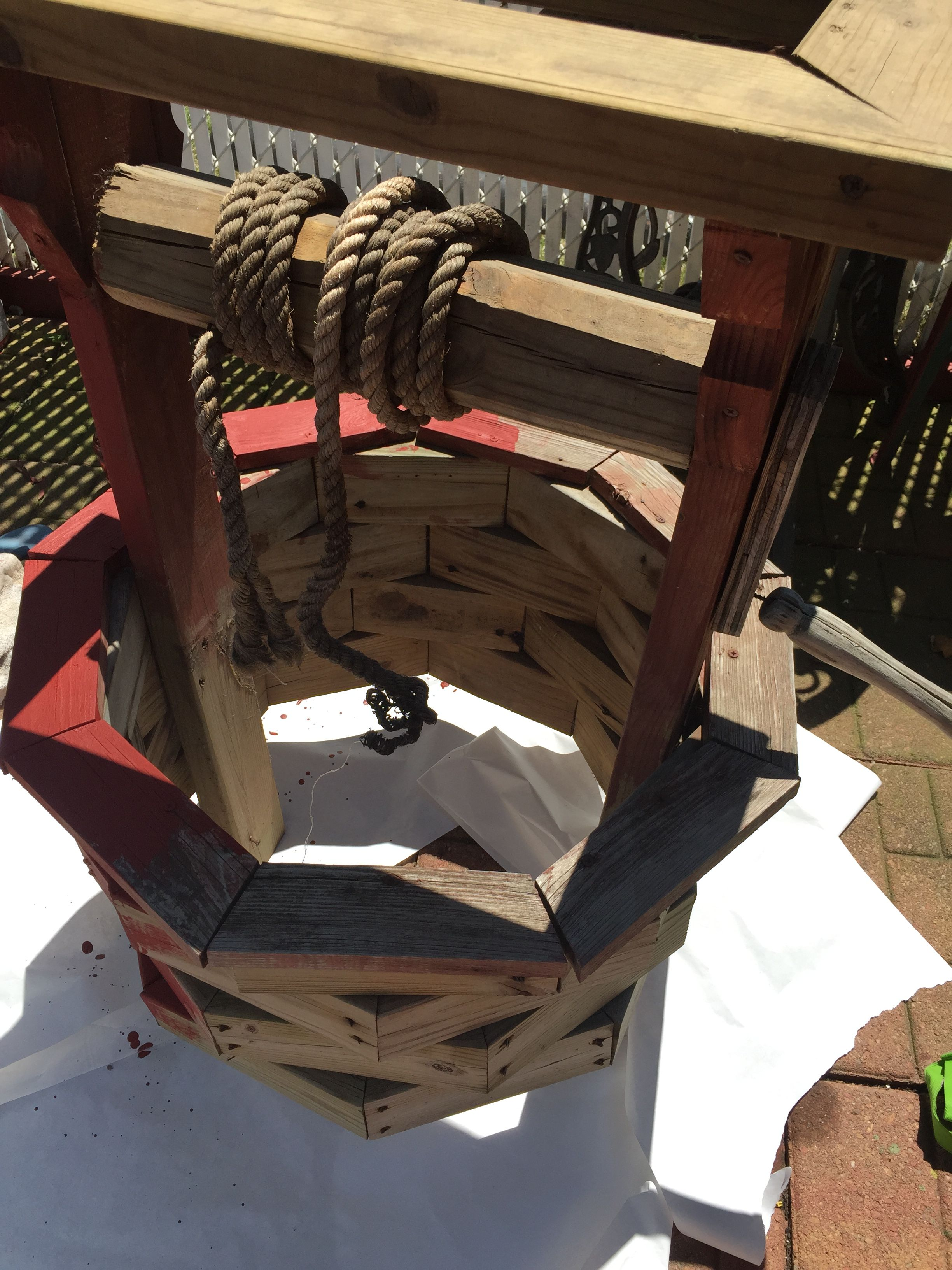 Painting my newly repaired wishing well