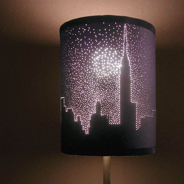 Use pinholes in a dark lampshade to make a design.  This is the NYC Skyline