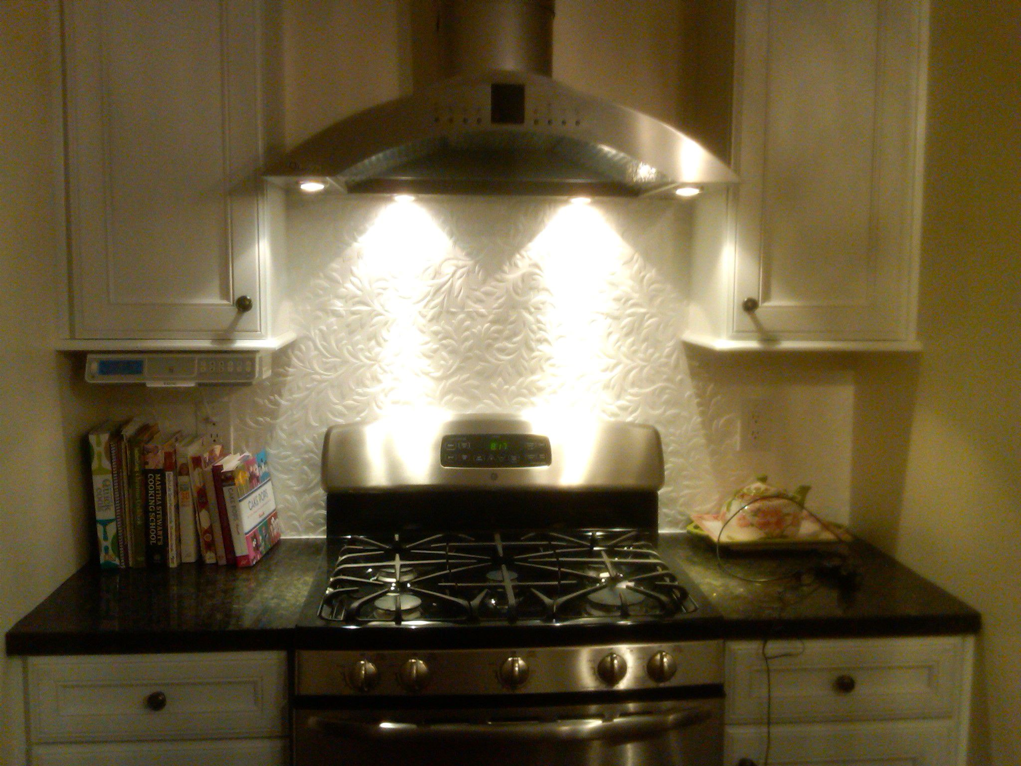 Wallpaper Backsplash - use Anaglypta textured wallpaper & paint with several coats of high gloss ...