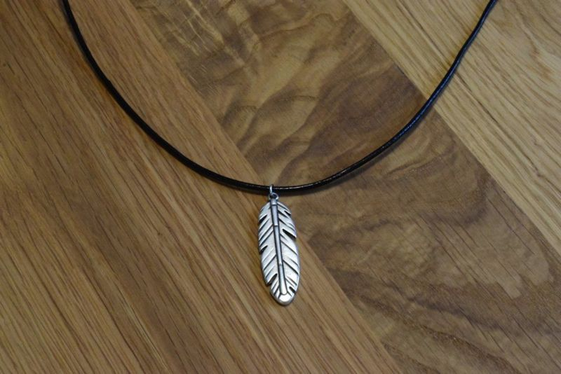 Leather necklace with a feather