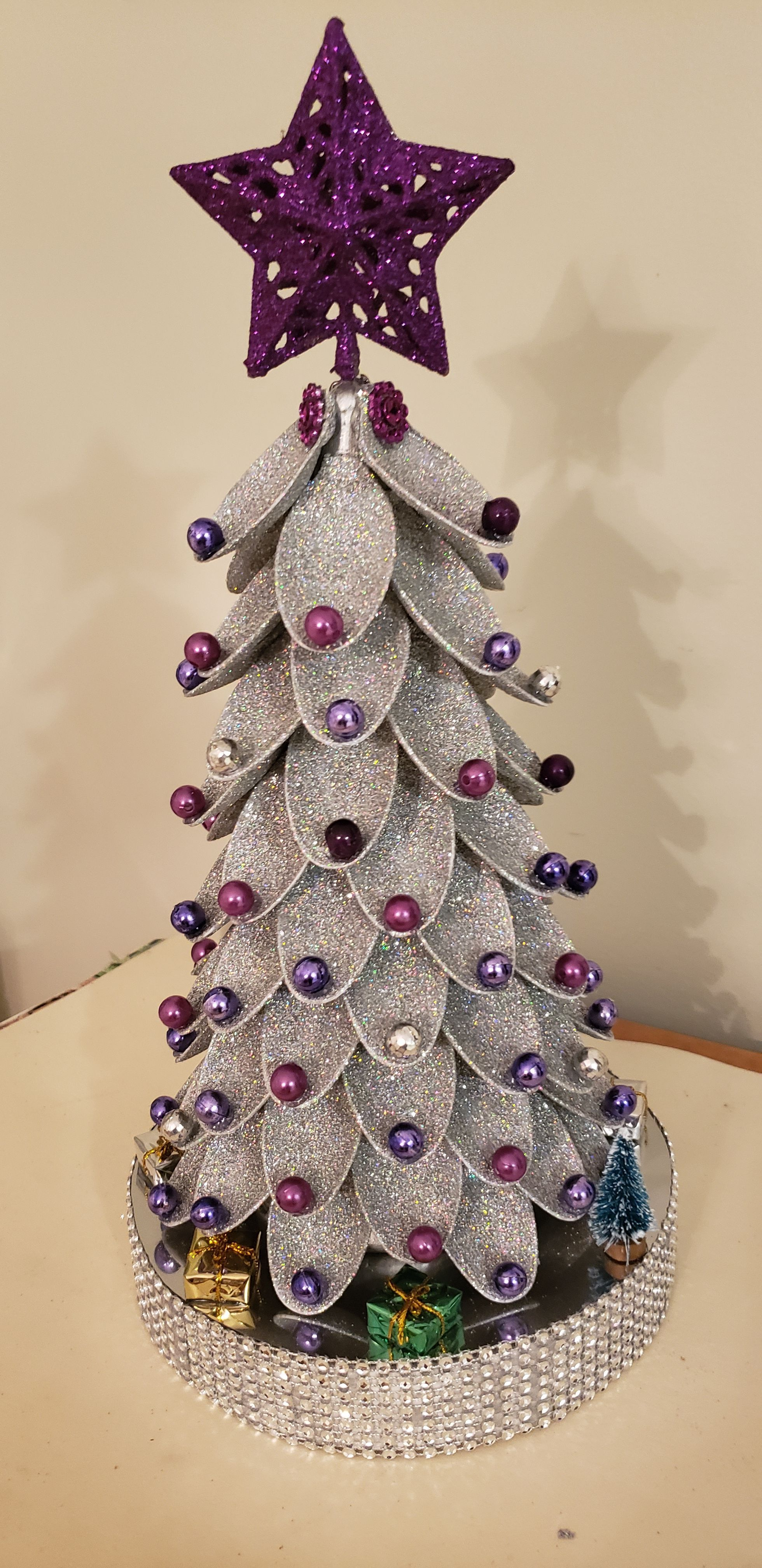 Small Christmas Tree - Purple and Silver #sunflowerchristmastree This is a small Christmas tree, accessorized with 3 types of purple beads, holographic silver glitter, foam, silver rhinestone mesh, decorations, purple star, sunflower mesh. This measures at 14 inches. #sunflowerchristmastree Small Christmas Tree - Purple and Silver #sunflowerchristmastree This is a small Christmas tree, accessorized with 3 types of purple beads, holographic silver glitter, foam, silver rhinestone mesh, decoration #sunflowerchristmastree