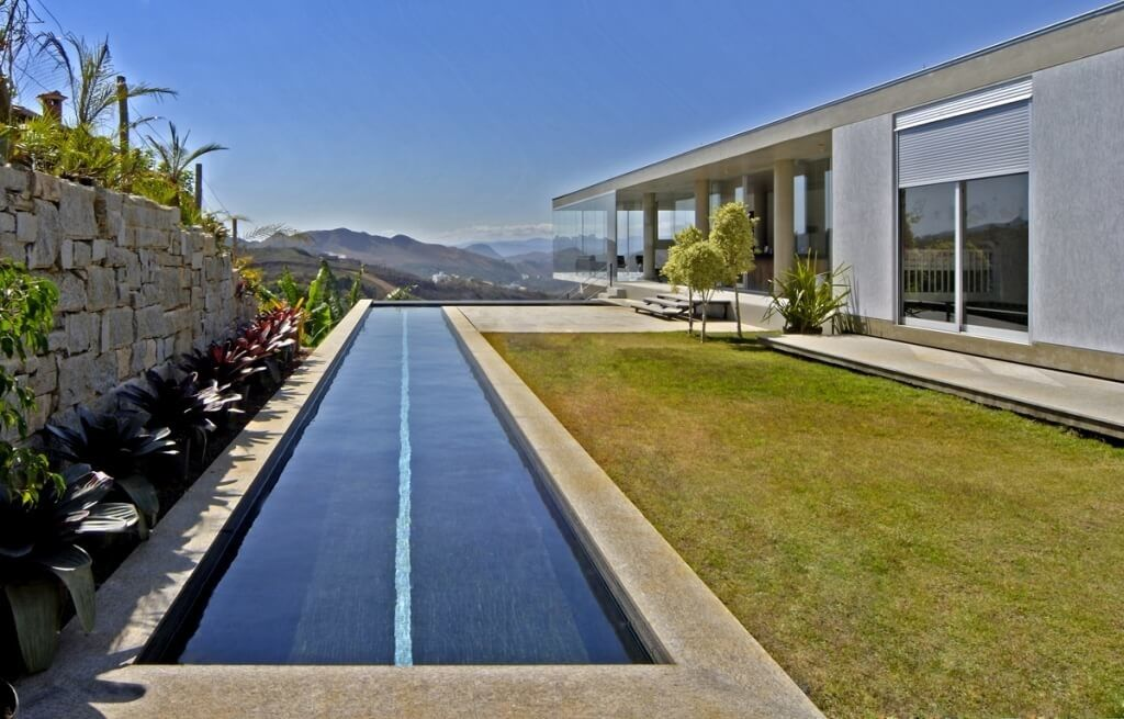 Impressive Lap Pool Design For Contemporary Home Alongside Stone Walls With  Amazing Mountain View
