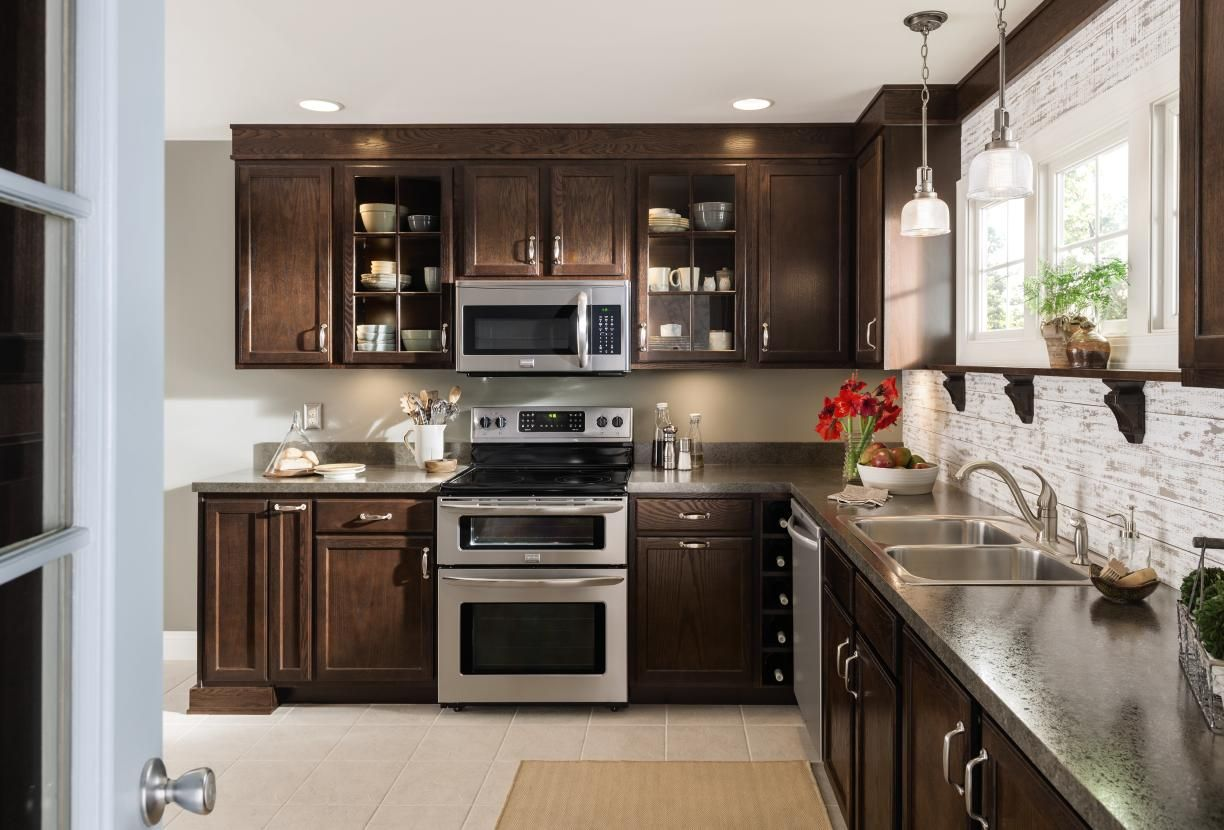 Paired With The Rich Deep Beauty Of Our Umber Finish Aristokraft S Oakland Door Style B Birch Kitchen Cabinets Kitchen Cabinetry Design Oak Kitchen Cabinets