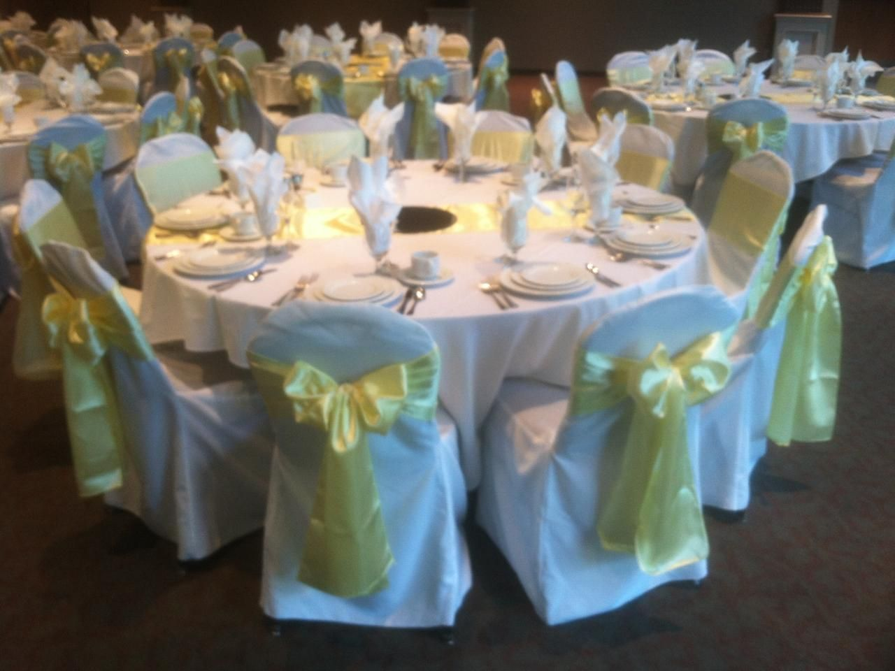 Light Yellow Satin Sashe On White Chair Cover