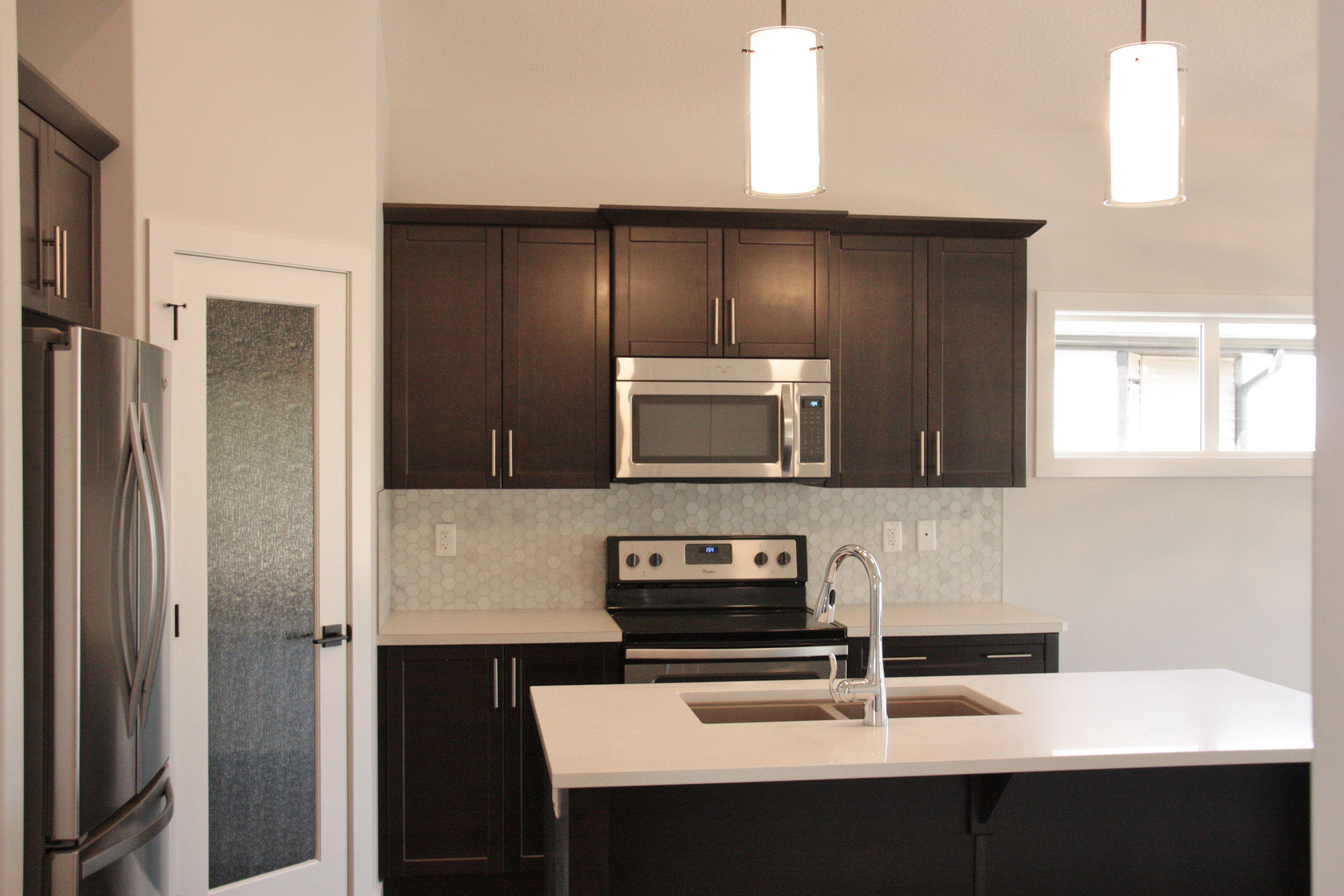 Best New Kitchen Dark Brown Cabinets White Quartz Island And 400 x 300