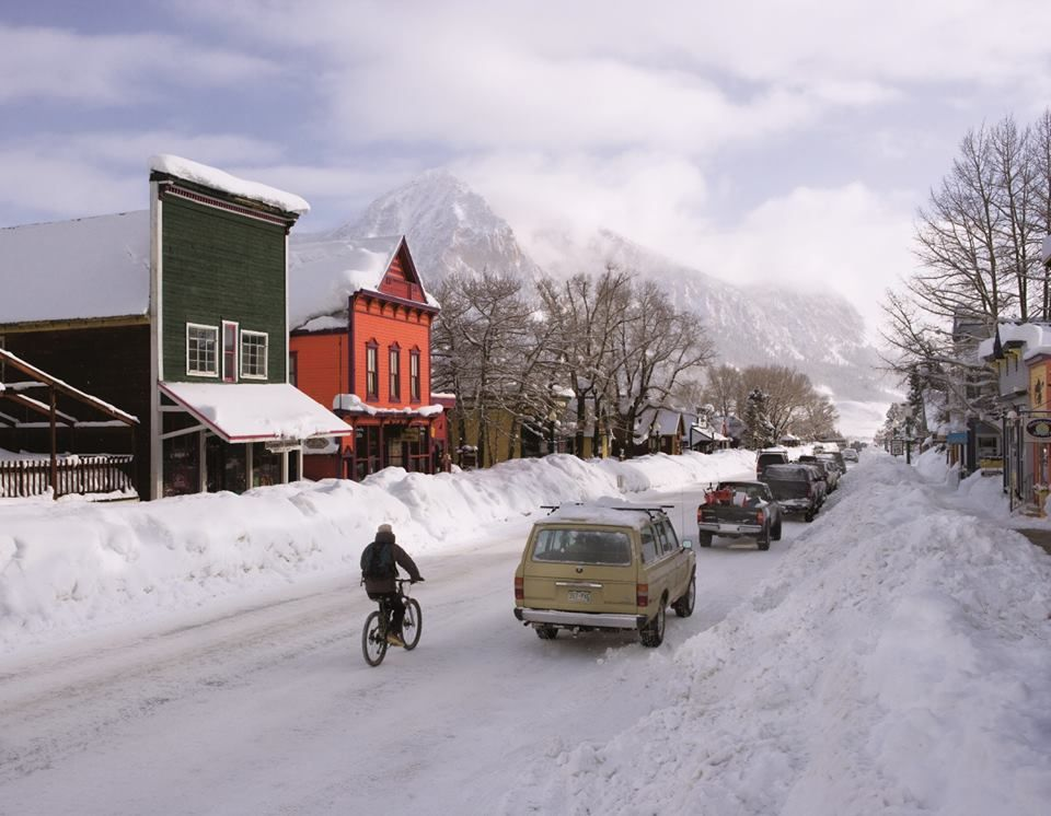 Riding your bike through town on a snowy day. #crestedbutte #wintertime