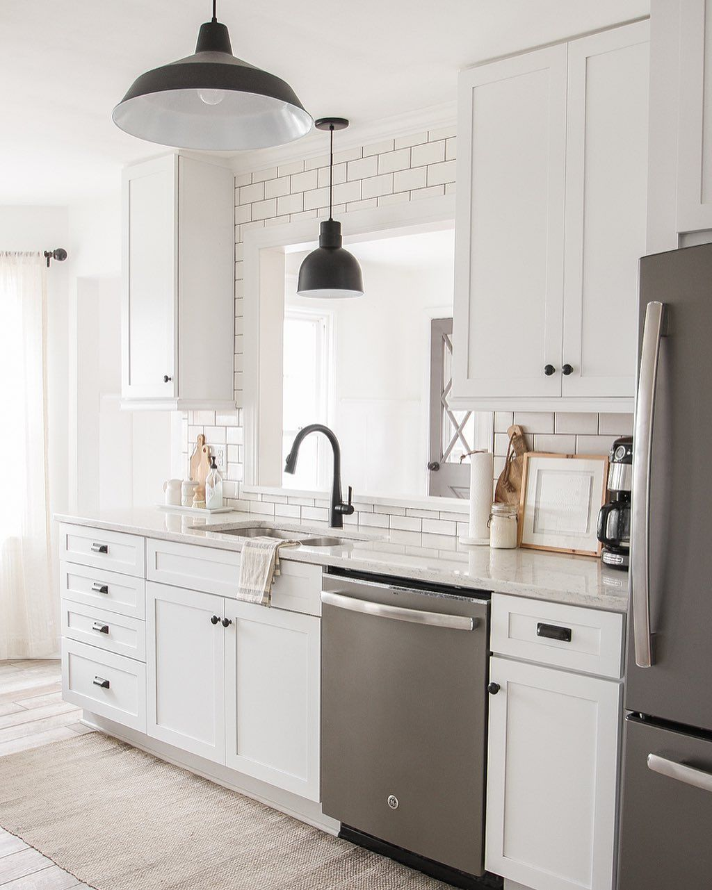 Softening The Farmhouse Love Grows Wild In 2020 Kitchen Cabinets With Black Appliances White Kitchen Design Kitchen Cabinets