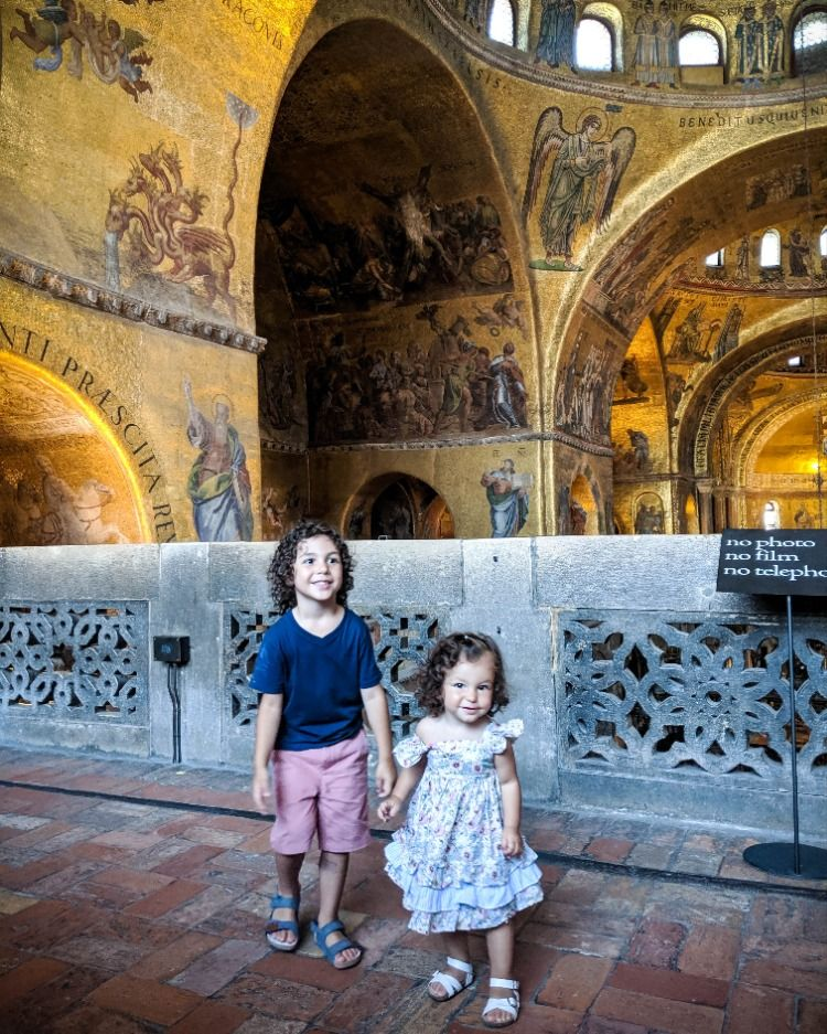 My favorite church in Italy was definitely Saint Mark's Basilica. It was absolutely stunning.  The art on the wall is so interesting and the kids loved looking at all the unique creatures in the paintings.  The kids appreciated the learning opportunity and the kids appreciated eye-spy opportunity👀😁   #basilicadisanmarco #familytravelideas #familytravelgoals #takethekids #familytravel #art #church #bestfriends #momlife #artistic #travelphotography #worldschool #travelandlearn #homeschool