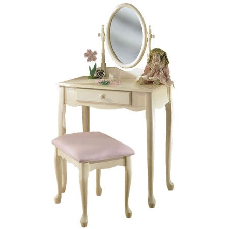 Off-white child\u0027s vanity with a scalloped apron and oval mirror