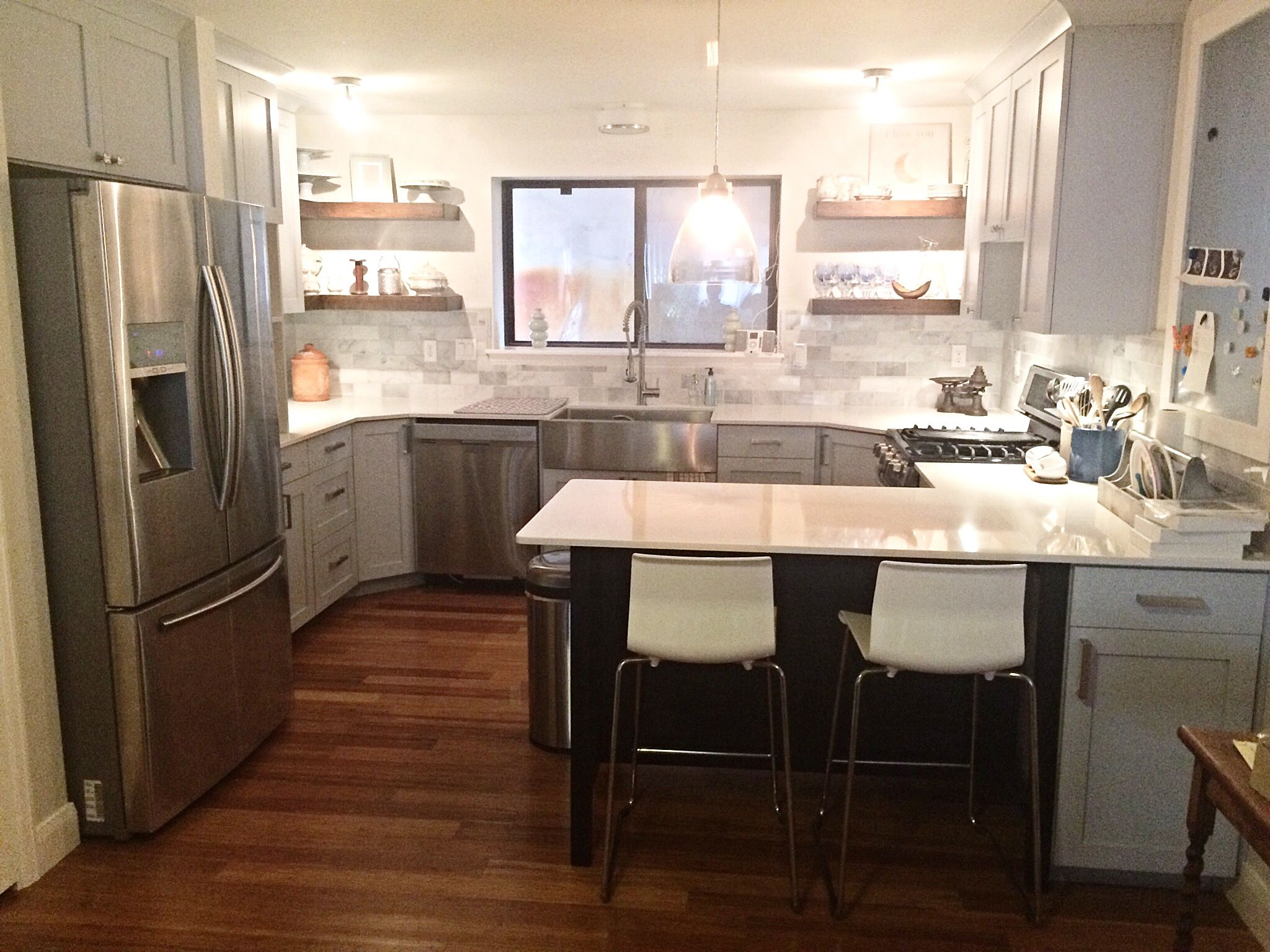 Custom Shaker Style Cabinets Accented By Chipped Ice Quartz Countertops,  Bamboo Hardwood Flooring And Dark