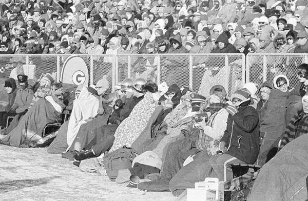 No matter whether they sat on the field or in the stands, Packers fans covered as much of themselves as possible to stay warm on the 13-below- zero day. Press-Gazette archives