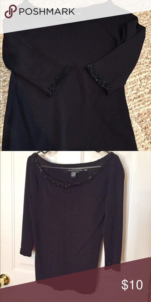 Beautiful top in black by Ziani Couture size s Very beautiful sophisticated black top with black shiny beets on the neckline and sleeve. Size S Ziani Couture Tops