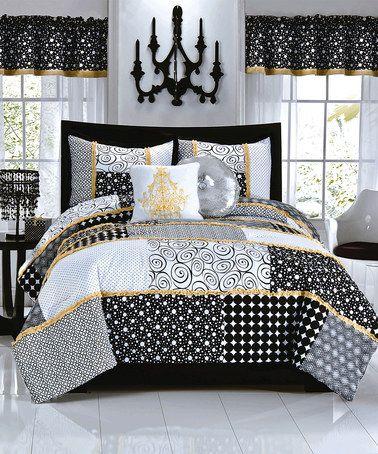 This Black White Polka Dot Comforter Set By Pem America Is