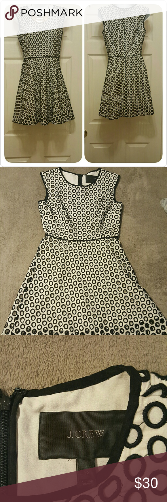 J.Crew winter white polka dot dress Gorgeous swing dress with seamless zipper and polka Dot cut outs Sz 00P J. Crew Dresses Asymmetrical