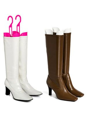 When you store tall boots, they often slouch to the side and end up with an unsightly crease in the leather. Preserve your investment with these handy boot shapers, which fit snugly inside each boot to keep it upright. They even have a h