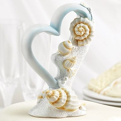 Seaside Jewels Cake Top http://mediaplus.carlsoncraft.com/Wedding/Cake-Toppers/ZB-ZBK1308-Seaside-Jewels-Cake-Top.pro Heart shaped resin cake top with seashells and white sparkling sand.