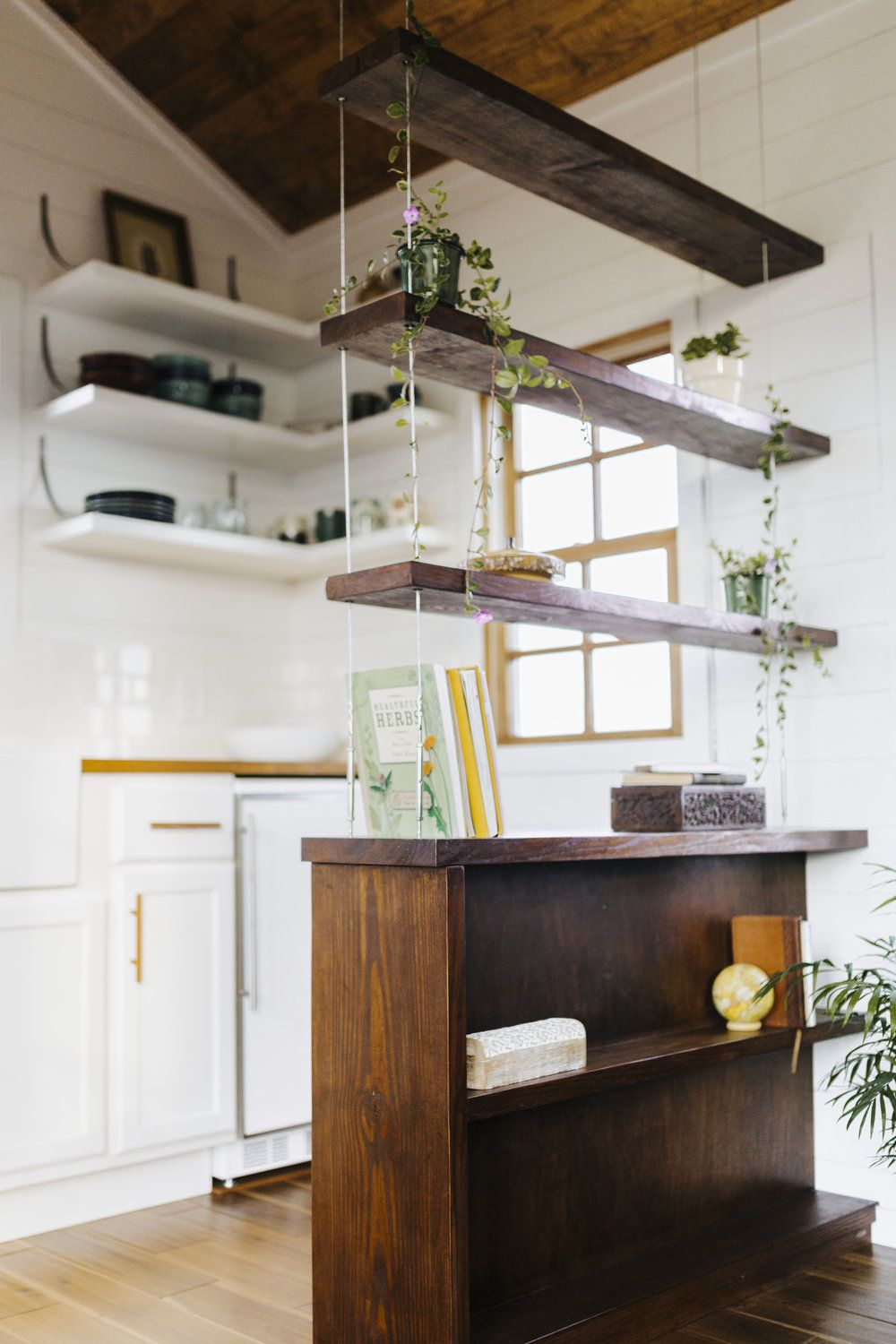 The Monocle By Wind River Tiny Homes Suspended Cable Shelving Shiplap Siding Open Shelving Hanging Shelf Kitchen Tiny House Kitchen Tiny House Storage