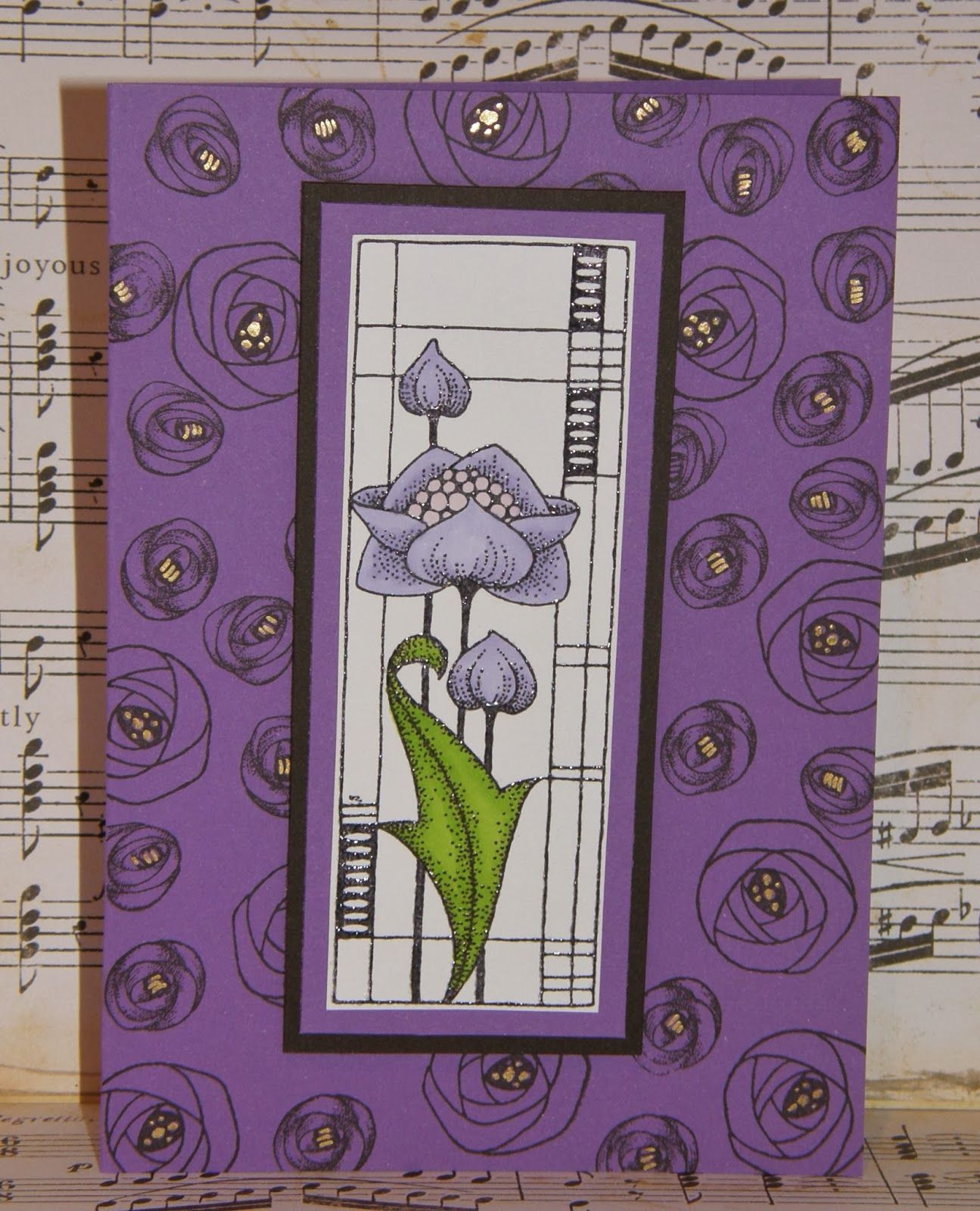 I don't usually start with coloured card but love this purple and stamped the roses from the set with Versafine Black Ink and added gold Stickles to the centres. The centre flower panel is stamped with black ink and heat embossed with clear powder. I coloured only the flower with Alcohol pens as I wanted the flower to stand out. The panel was matted onto purple and black and fixed to the card with foam pads. Thanks for visiting and pop by again as the DT have lots more inspirational cards…