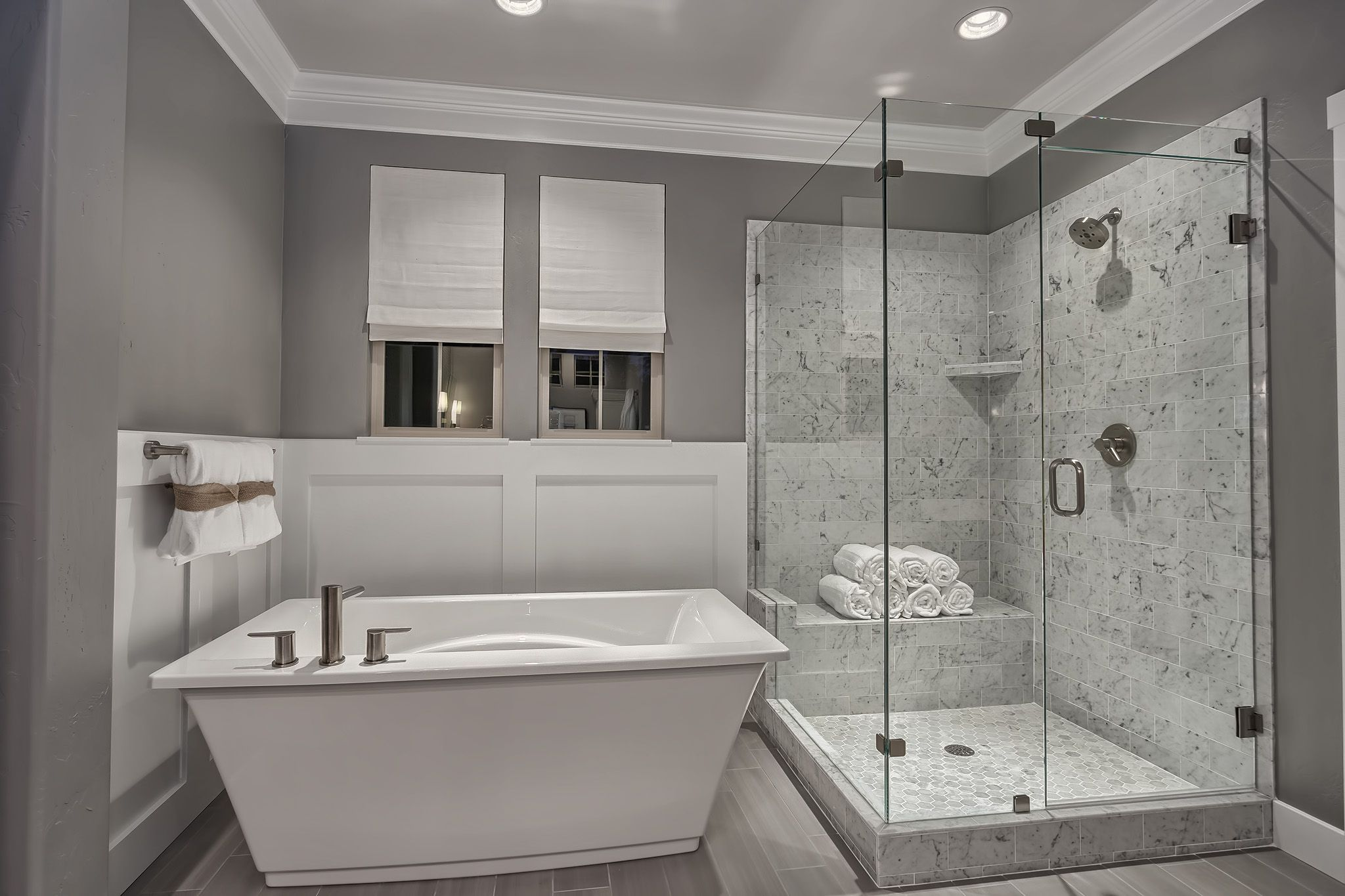 Free Standing Tub With Wainscoting Accentuate The Stone Surround