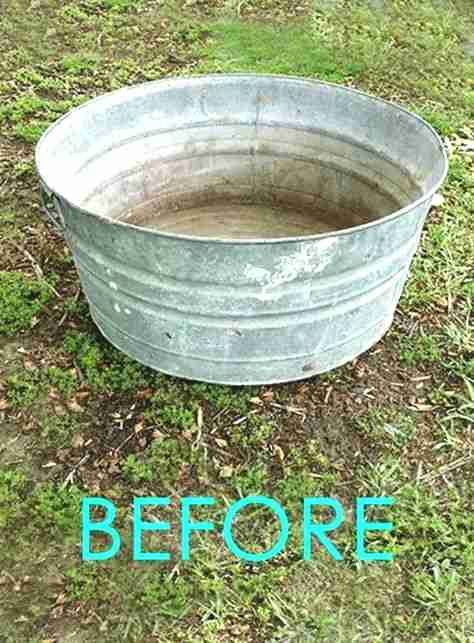 An old galvanized tub transformed into a beautiful outdoor patio piece in 30 minutes! GORGEOUS!!   #upcycle #upcycling #backyard #gardens #gardening #gardeningtips #urbangardening #gardendesign #gardenideas #containergardening #diy #summer #patiodesigns #patio #bohemian #bohemiandecor #bohochic #boho #curbappeal #pond #fountain