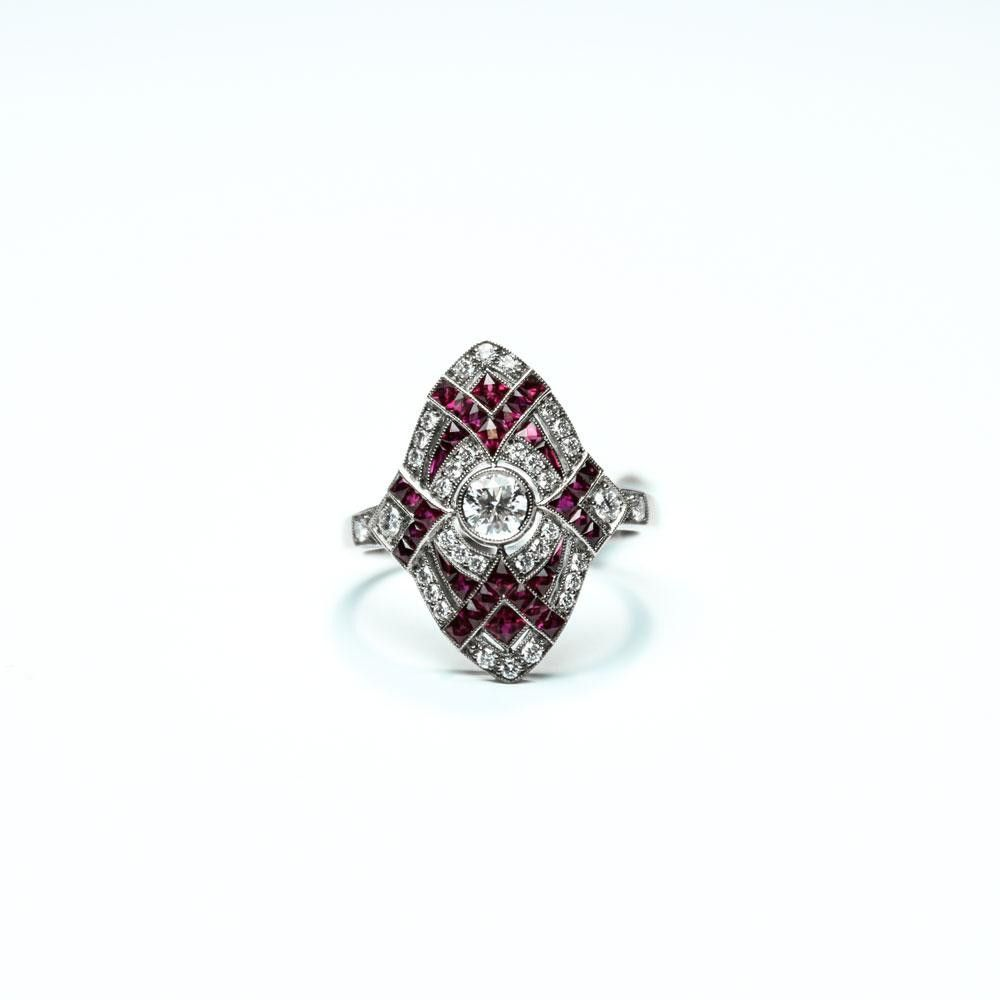 Stunning Vintage-Inspired 18K White Gold Ring Wint 34 Rubies (0.65 Carats) And 35 Diamonds (0.49 Carats).