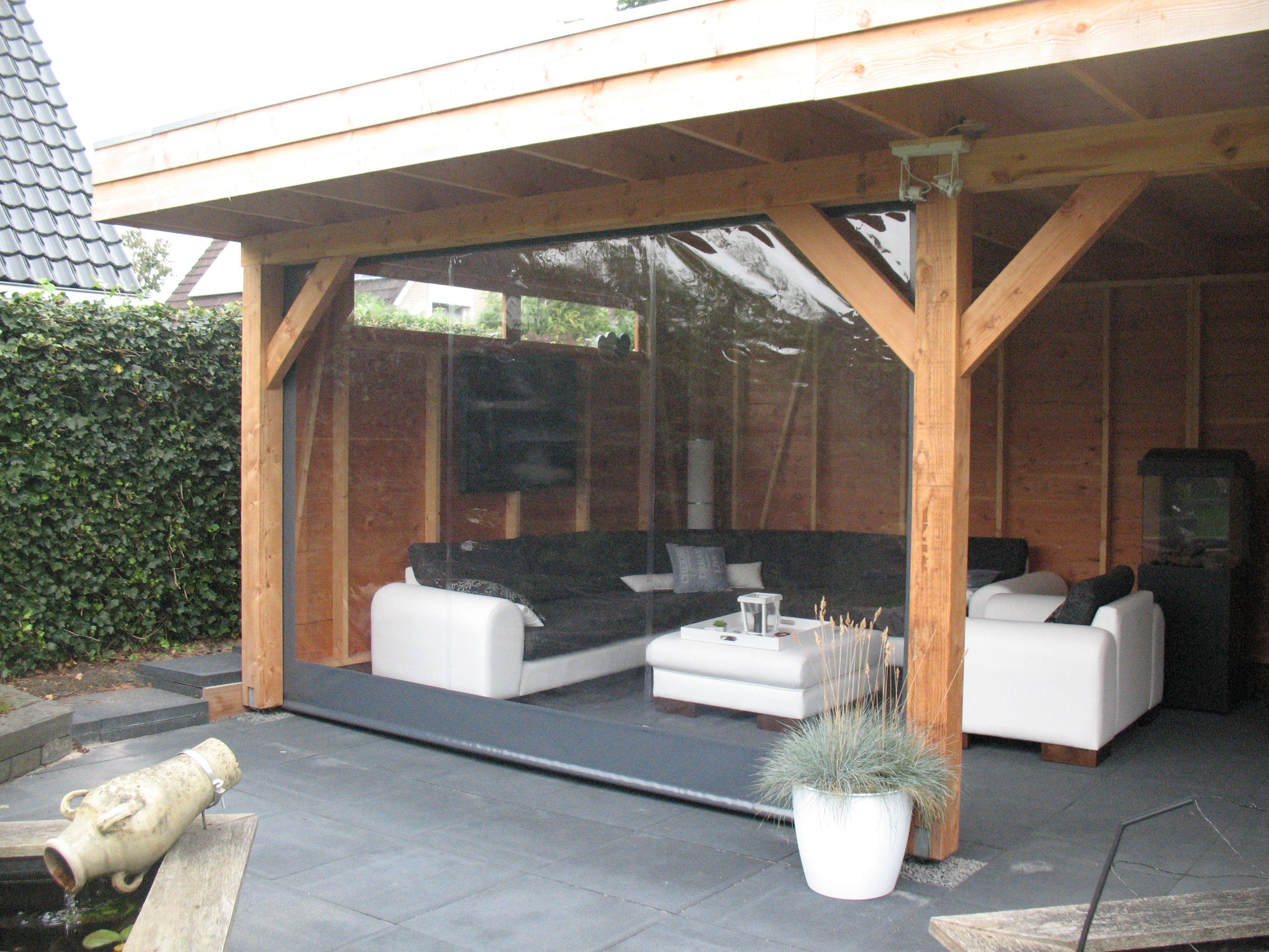 Overdekte terras van larix met terraszeil tuin inrichting