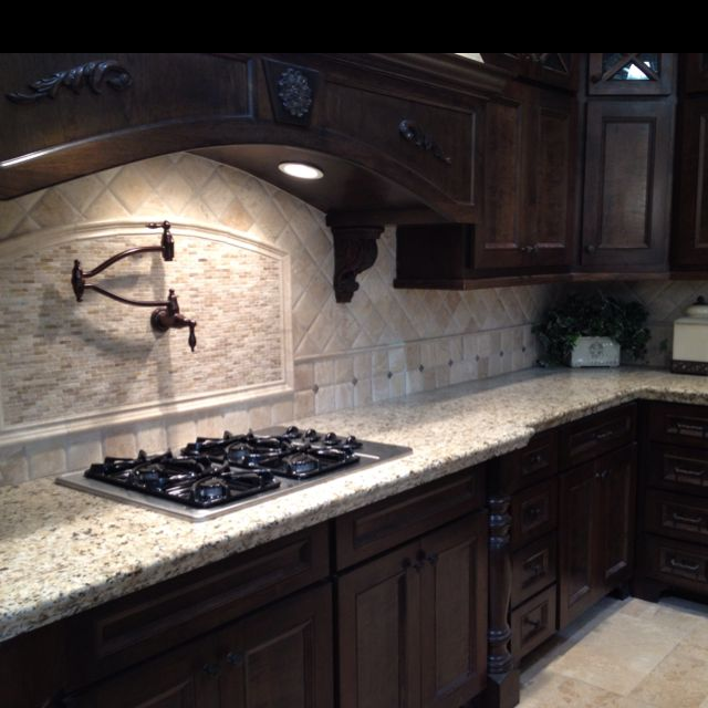 Dark Cabinet With Light Tile Back Splash.