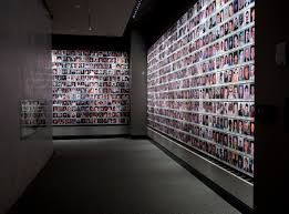 THE FACES OF THE VICTIMS   - THE  MEMORIAM WALL AT THE 911 WTC MUSEUM