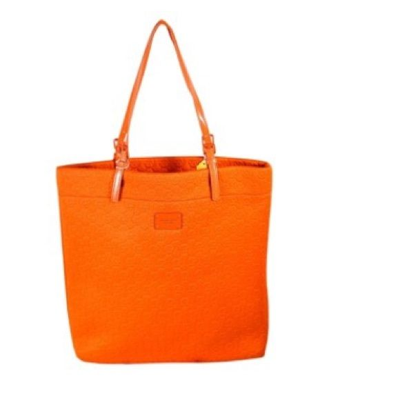 Not new !!! Michael Kors orange neoprene bag. Michael Kors orange neoprene bag. Love it but not new. One year old has wear. Also has black spots. They say you can clean with soap and water but it hasn't worked for me. It's from rubbing up against dark fabric such as coats and dark jeans.  Has original straps. Would be great for the beach since it's not new! Michael Kors Bags