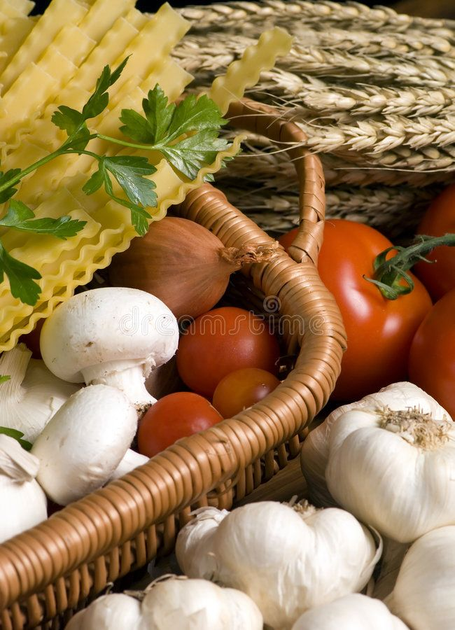 Italian Pasta 2. Fresh tomatoes, garlic, onions and mushrooms await preparation ,