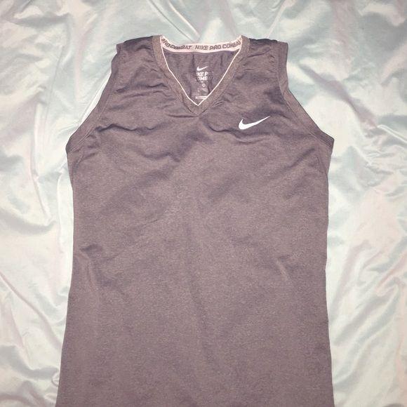 Nike Dri-fit Nike pro combat Dri-Fit compression XL. Worn once. Don't like that it's sleeveless. Like New. Nike Tops