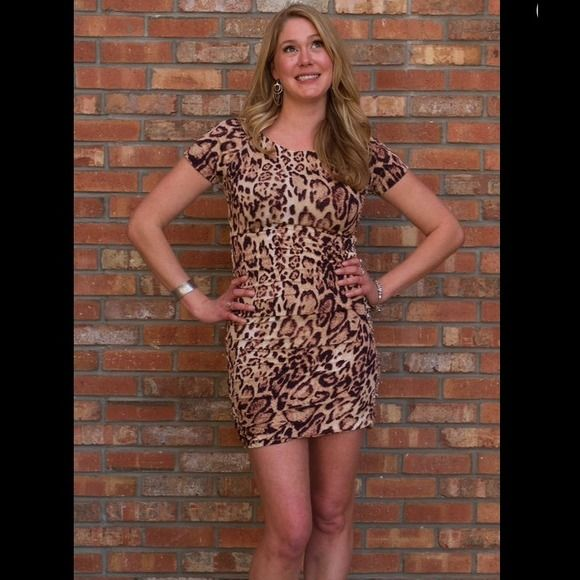 NEW Leopard Rockabilly Dress! This sexy animal print dress fits in all the right places! Retro Boat neck with cap sleeves and ruching down the side to nip you in at the waist and bring you out at the hips! 95% Polyester, 5% Spandex. Dresses