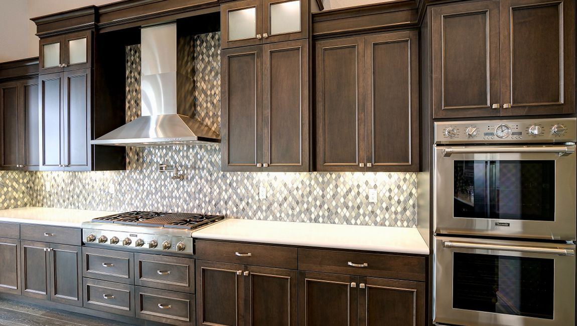 Dark Brown Stained Cabinets With A Gorgeous Blue And Grey