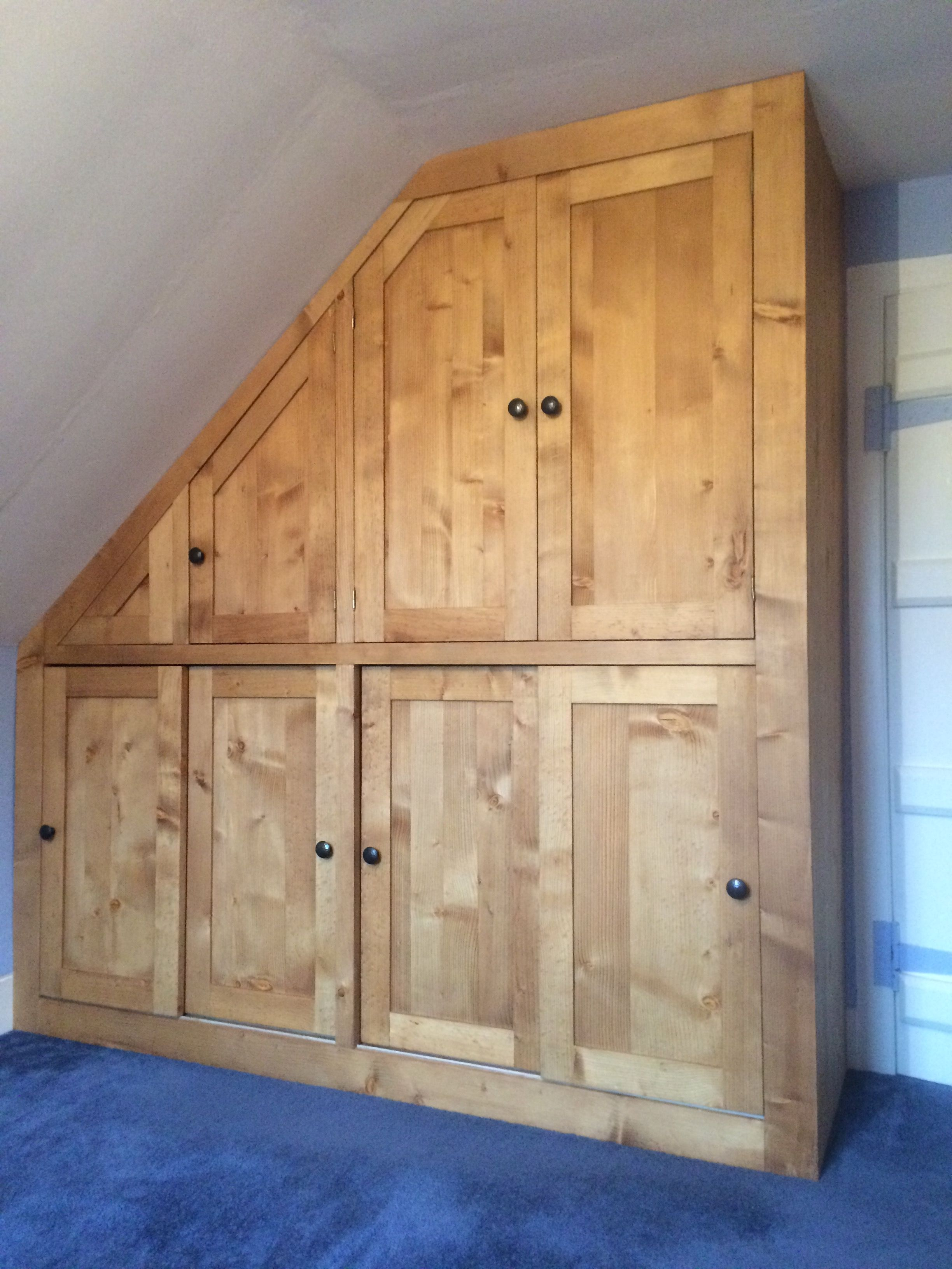 clever design wardrobes for bedroom. Maximise storage with clever design like this solid wood bespoke fitted  wardrobe in the eaves of