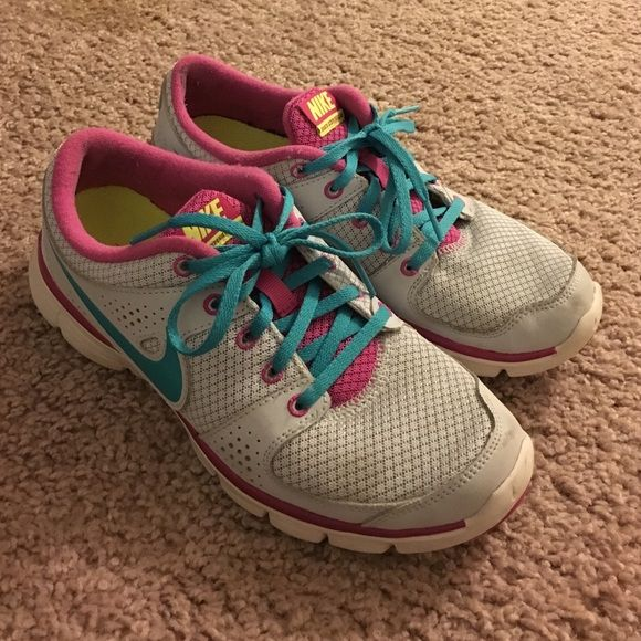 Nike Flex Experience RN Nike Flex Experience RN running shoes in grey, pink and teal. They are in good condition, with the exception of the small stain on the front of the right shoe (pictured). Have only been worn a handful of times and still have a ton of life in them! Nike Shoes Sneakers