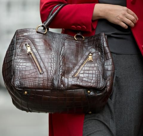1611b836a2ac40 Burgundy distressed crocodile large expandable bag with brass details. The  leather is beautifully applied with