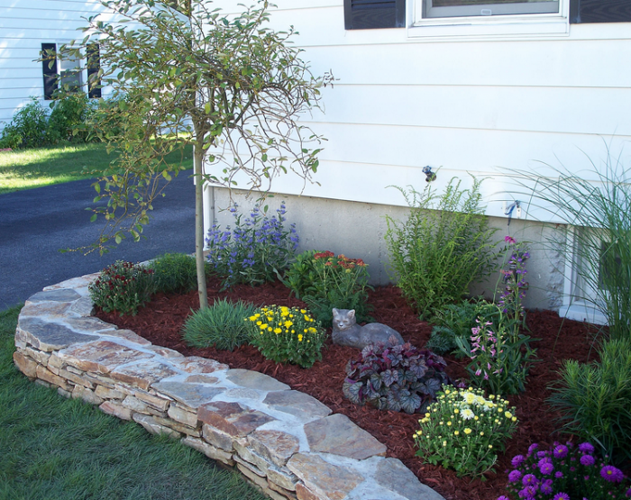 Raised flower beds in front of house Front yard