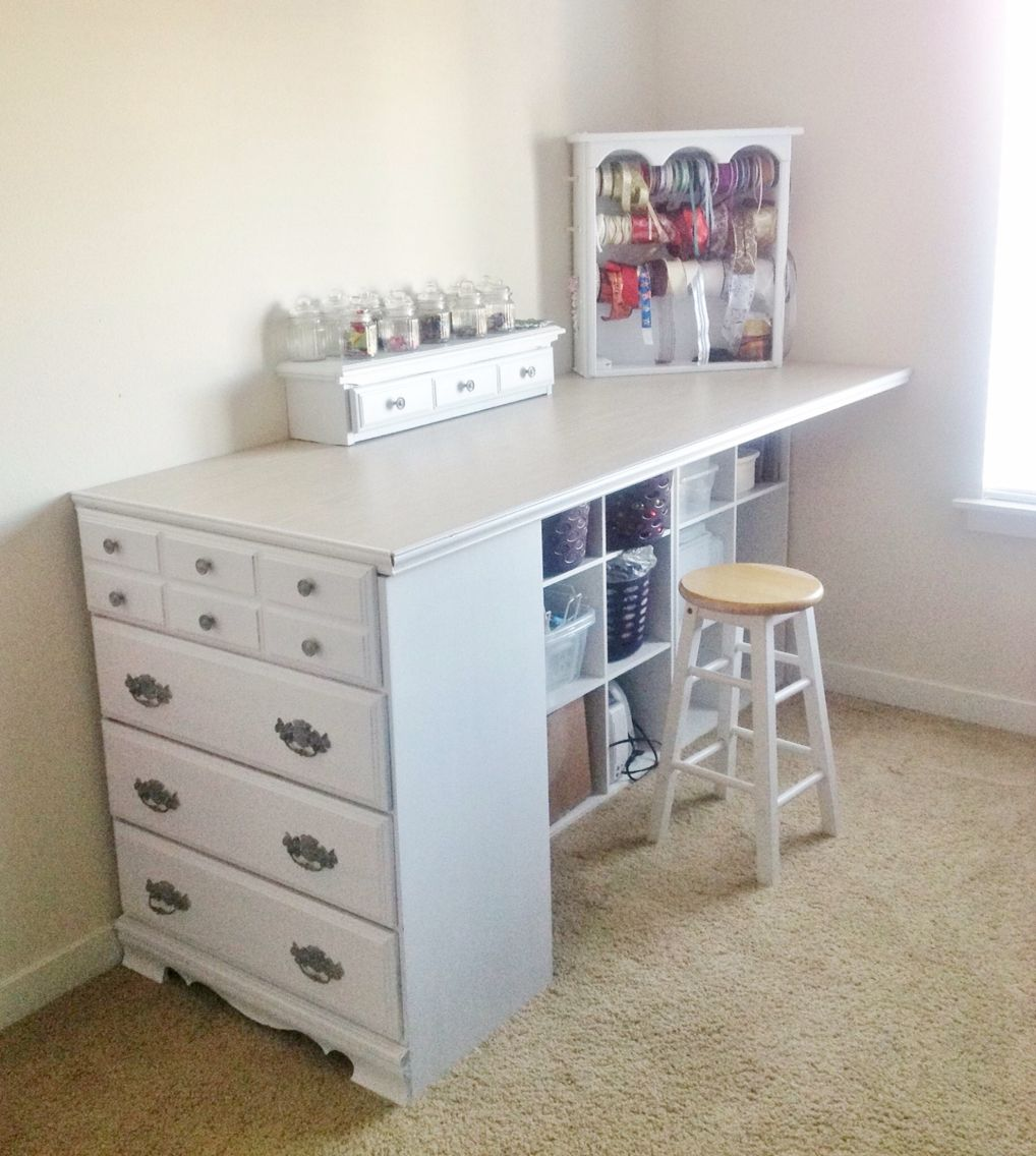 Short small repurposed dresser made into craft table shelving under